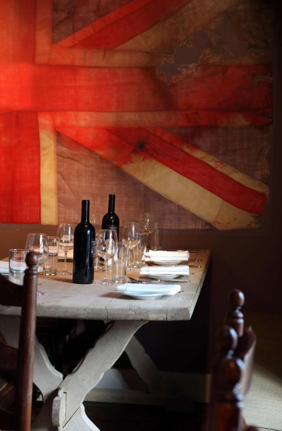 Dining table with large union jack flag in the background